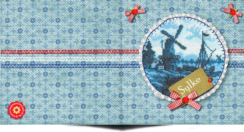 Hollands geboortekaartje vintage met borduursels, oud hollandse tegeltjes, molentje en strikje maakt het een uniek geboortekaartje.