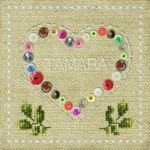 Geboortekaartje vintage met hart van knopen en stiksels. Er zijn zelfs blaadjes geborduurd zodat het net op een handwerkje lijkt.